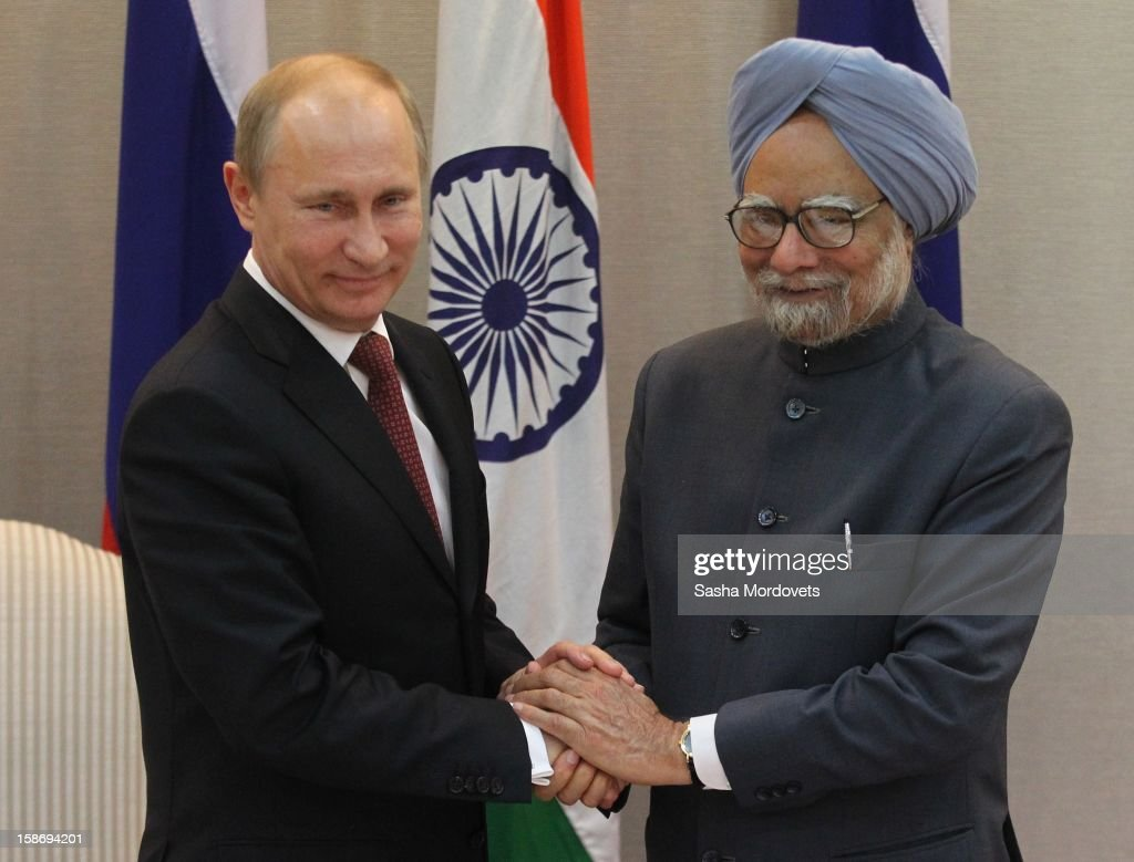 Russian President Vladimir Putin (L) greets Indian President Manmohan Singh (R) during a meeting on December 24, 2012 in New Delhi, India. President Putin is on a two-day visit to India. Russia and India have signed a new weapons deals worth billions of dollars, it was announced today.