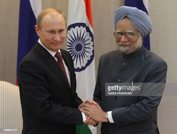 Russian President Vladimir Putin greets Indian President Manmohan Singh during a meeting on December 24 2012 in New Delhi India President Putin is on...