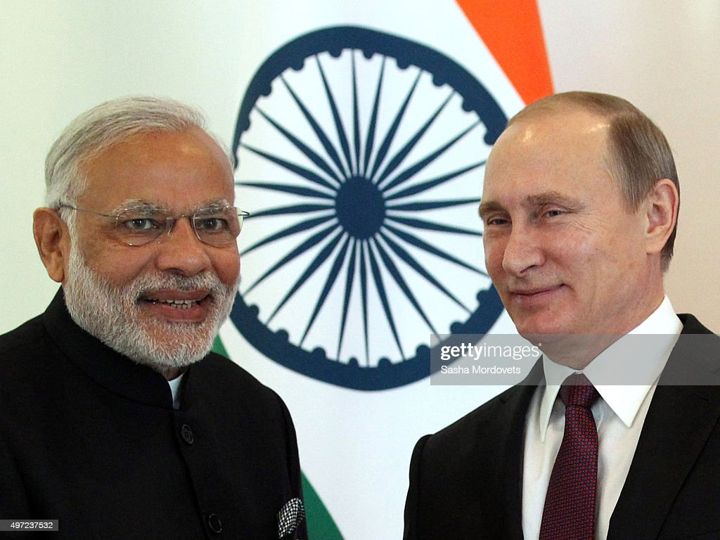 Russian President <a gi-track='captionPersonalityLinkClicked' href=/galleries/search?phrase=Vladimir+Putin&family=editorial&specificpeople=154896 ng-click='$event.stopPropagation()'>Vladimir Putin</a> (R) greets Indian Prime Minister <a gi-track='captionPersonalityLinkClicked' href=/galleries/search?phrase=Narendra+Modi&family=editorial&specificpeople=822611 ng-click='$event.stopPropagation()'>Narendra Modi</a> (L) during the BRICS leaders meeting prior to G20 Antalya Summit in Belek, near Antalya on November 15, 2015 in Turkey. World leaders, delegates and media are attending the summit in Turkey in the wake of the Paris terror attacks which were claimed by Islamic State. The need to address the situation in Syria and the migration crisis will be high on the aganda.