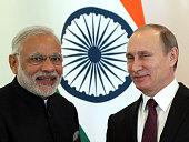 Russian President Vladimir Putin greets Indian Prime Minister Narendra Modi during the BRICS leaders meeting prior to G20 Antalya Summit in Belek...
