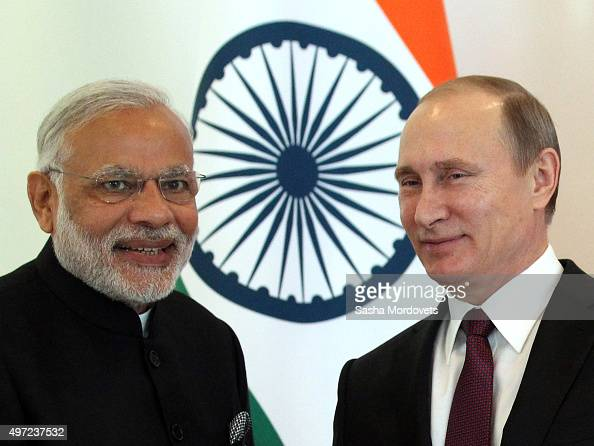 Russian President Vladimir Putin greets Indian Prime Minister Narendra Modi during the BRICS leaders meeting prior to G20 Antalya Summit in Belek...