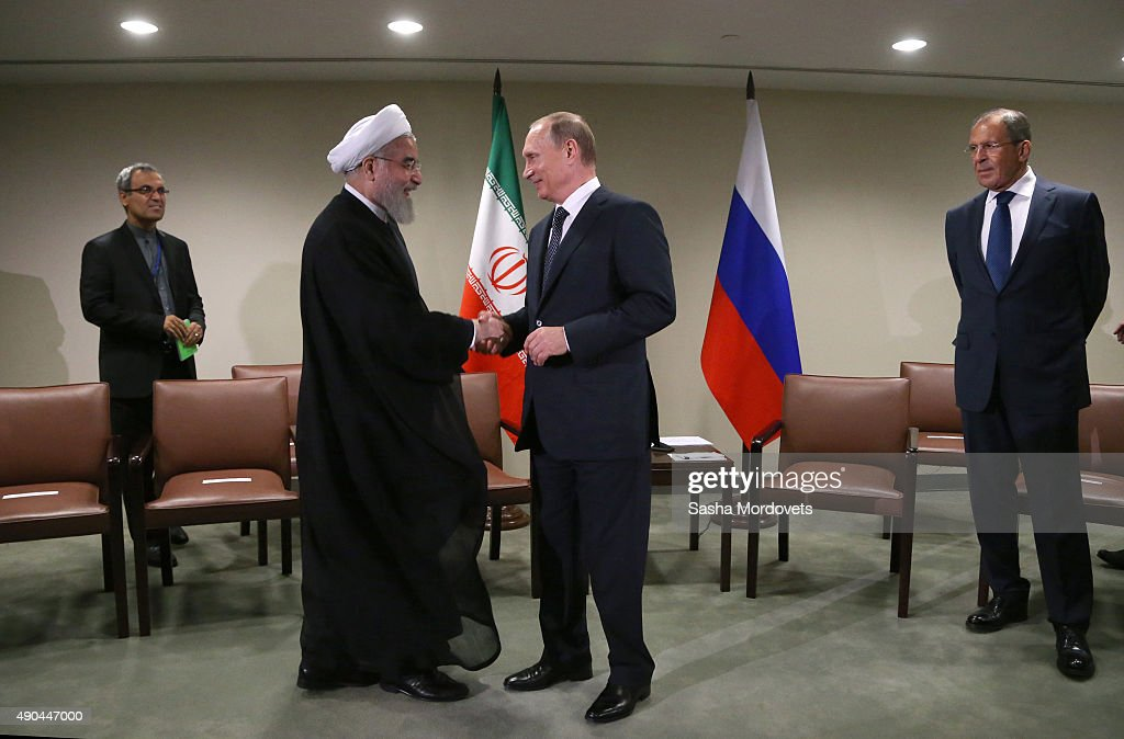 Russian President <a gi-track='captionPersonalityLinkClicked' href=/galleries/search?phrase=Vladimir+Putin&family=editorial&specificpeople=154896 ng-click='$event.stopPropagation()'>Vladimir Putin</a> (R) greets Iran's President <a gi-track='captionPersonalityLinkClicked' href=/galleries/search?phrase=Hassan+Rouhani+-+Politico&family=editorial&specificpeople=641593 ng-click='$event.stopPropagation()'>Hassan Rouhani</a> (L) during their bilateral meeting in the UN Headquatters on September 28, 2015 in New York City. The ongoing war in Syria and the refugee crisis it has spawned are playing a backdrop to this years 70th annual General Assembly meeting of global leaders.