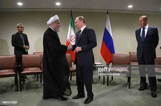 Russian President Vladimir Putin greets Iran's President Hassan Rouhani during their bilateral meeting in the UN Headquatters on September 28 2015 in...