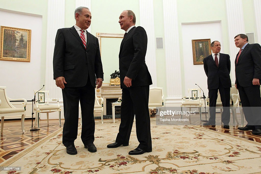 Russian President Vladimir Putin (2L) greets Israeli Prime Minister Benjamin Netanyahu (L) as Russian Foreign Minister Sergey Lavrov (2R) and Presdential Advisor Yuri Ushakov look on during the Security Council meeting in the Kremlin on November 20,2013 Moscow, Russia. Members of the Security Council discussed the ecology problems going on in the country today.