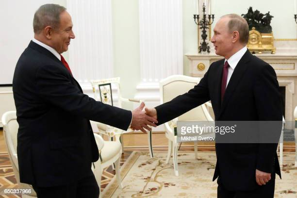 Russian President Vladimir Putin greets Israeli Prime Minister Benjamin Netanyahu during their talks at the Kremlin on March 9 2017 in Moscow Russia...