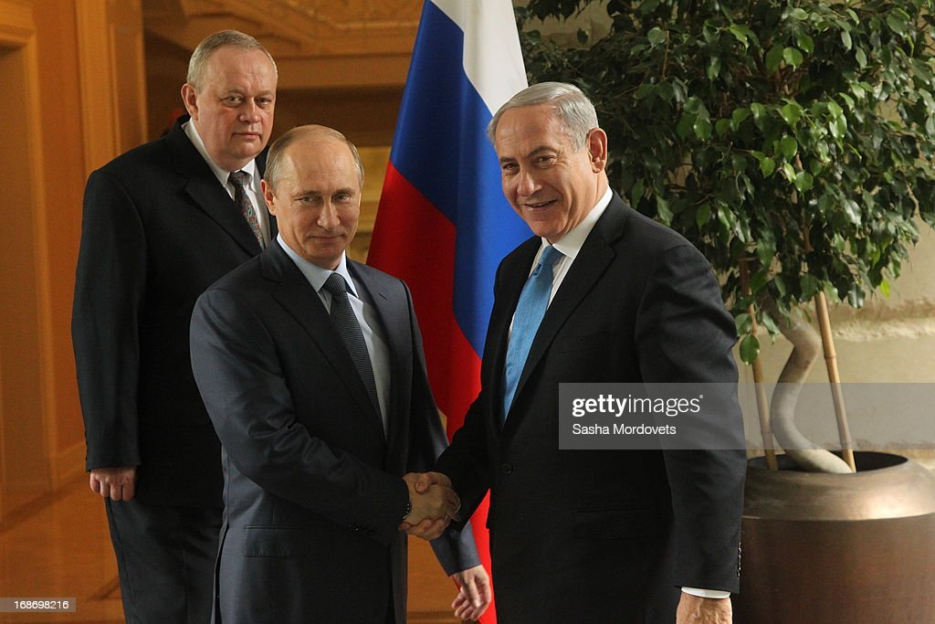 Russian President <a gi-track='captionPersonalityLinkClicked' href=/galleries/search?phrase=Vladimir+Putin&family=editorial&specificpeople=154896 ng-click='$event.stopPropagation()'>Vladimir Putin</a> (L) greets Israel's Prime Minister <a gi-track='captionPersonalityLinkClicked' href=/galleries/search?phrase=Benjamin+Netanyahu&family=editorial&specificpeople=118594 ng-click='$event.stopPropagation()'>Benjamin Netanyahu</a> at Bocharov Rucheistate residence on May 14, 2013 in Sochi, Russia. According to reports, Israel's concerns over Russian plans to sell Syrian President Bashar al-Assad an advanced air defense system will be raised.