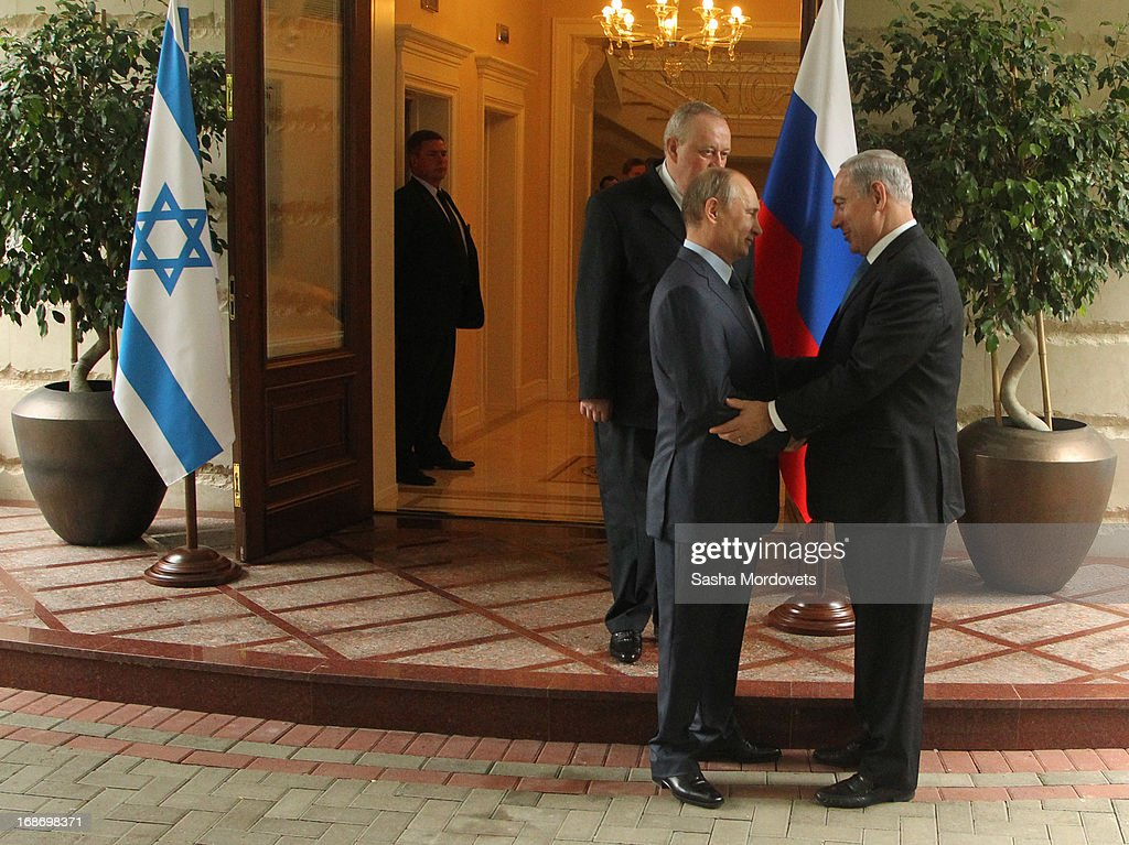 Russian President <a gi-track='captionPersonalityLinkClicked' href=/galleries/search?phrase=Vladimir+Putin&family=editorial&specificpeople=154896 ng-click='$event.stopPropagation()'>Vladimir Putin</a> greets Israel's Prime Minister <a gi-track='captionPersonalityLinkClicked' href=/galleries/search?phrase=Benjamin+Netanyahu&family=editorial&specificpeople=118594 ng-click='$event.stopPropagation()'>Benjamin Netanyahu</a> at Bocharov Ruchei state residence on May 14, 2013 in Sochi, Russia. According to reports, Israel's concerns over Russian plans to sell Syrian President Bashar al-Assad an advanced air defense system will be raised.