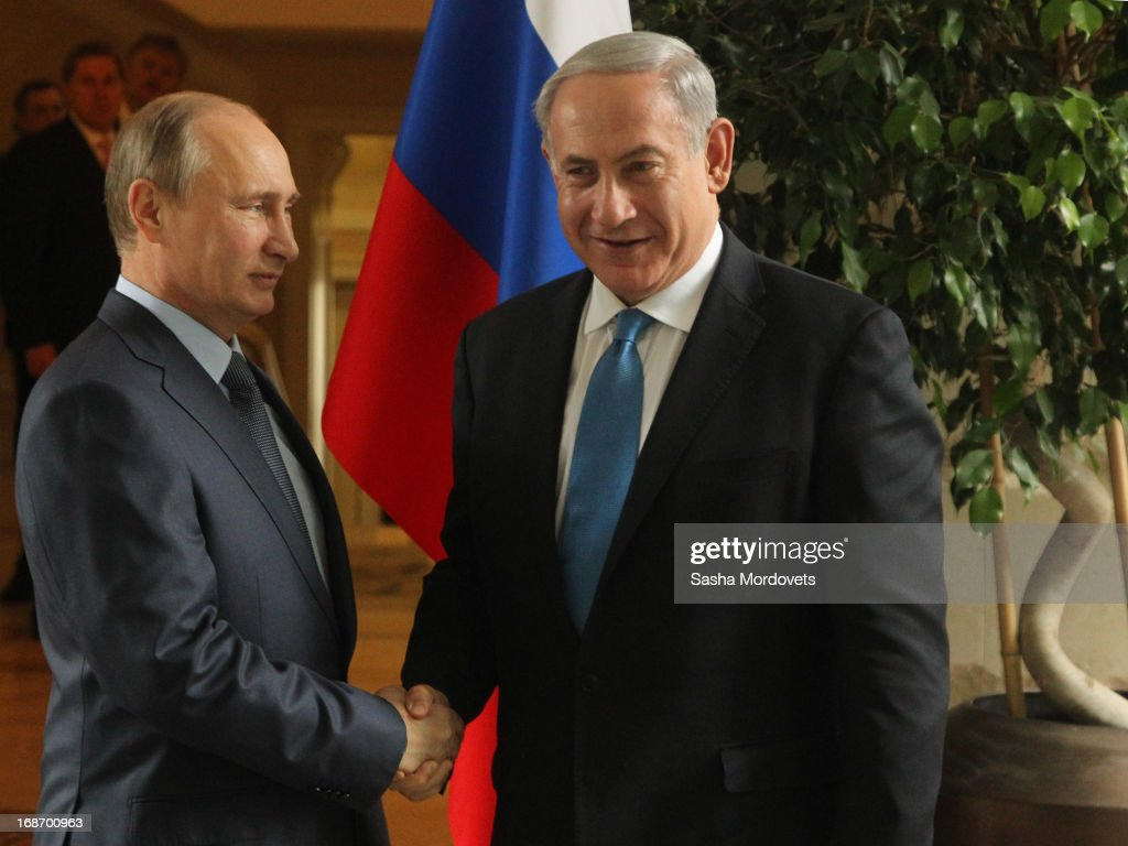 Russian President <a gi-track='captionPersonalityLinkClicked' href=/galleries/search?phrase=Vladimir+Putin&family=editorial&specificpeople=154896 ng-click='$event.stopPropagation()'>Vladimir Putin</a> (L) greets Israel's Prime Minister <a gi-track='captionPersonalityLinkClicked' href=/galleries/search?phrase=Benjamin+Netanyahu&family=editorial&specificpeople=118594 ng-click='$event.stopPropagation()'>Benjamin Netanyahu</a> at Bocharov Ruchei state residence on May 14, 2013 in Sochi, Russia. According to reports, Israel's concerns over Russian plans to sell Syrian President Bashar al-Assad an advanced air defense system will be raised.