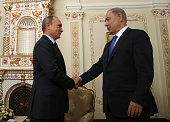 Russian President Vladimir Putin greets Israel's Prime Minister Benjamin Netanyahu during their talks in NovoOgaryovos State Residence on September...