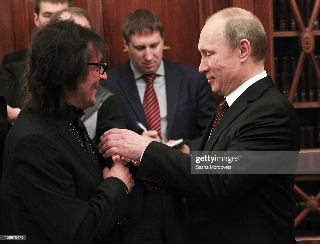 Russian President Vladimir Putin (R) greets musician Yuri Bashmet January 24, 2013 in Moscow, Russia. Bashmet was celebrating his 60th birthday.