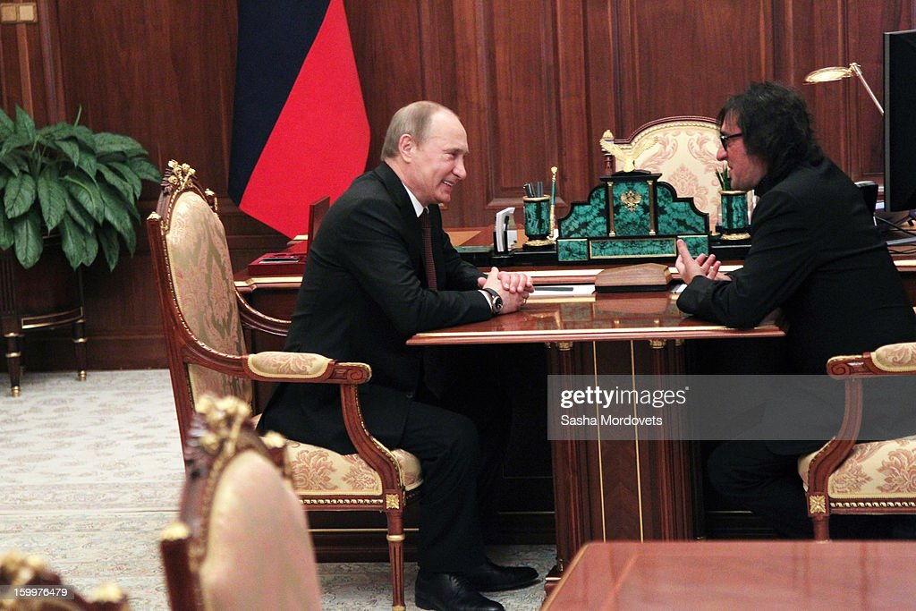 Russian President Vladimir Putin (L) greets musician Yuri Bashmet January 24, 2013 in Moscow, Russia. Bashmet was celebrating his 60th birthday.