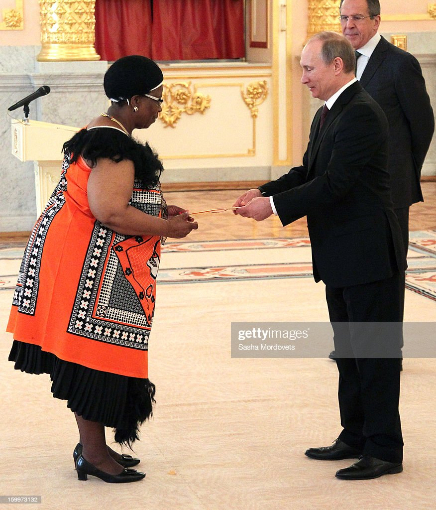 Russian President <a gi-track='captionPersonalityLinkClicked' href=/galleries/search?phrase=Vladimir+Putin&family=editorial&specificpeople=154896 ng-click='$event.stopPropagation()'>Vladimir Putin</a> (R) greets new ambassador of Swaziland Tembayena Annastasia Dlamini during a reception for new ambassadors in the Alexander Hall of the Grand Kremlin Palace January 24, 2013 in Moscow, Russia. Putin received 20 new foreign ambassadors.