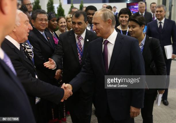Russian President Vladimir Putin greets participants of 137th InterParliamentary Union Assembly on October 14 2017 in Saint Petersburg Russia Putin...