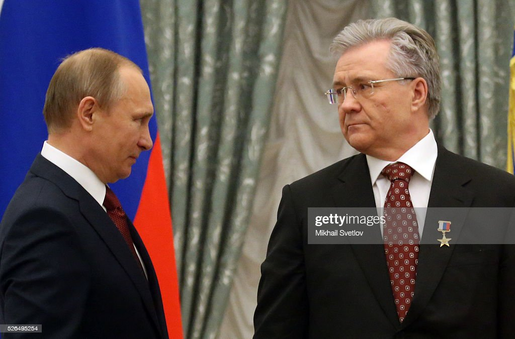 Russian President Vladimir Putin greets President of Surgutneftegas Vladimir Bogdanov (R) during the awarding ceremony at the Kremlin April, 30, 2016 in Moscow, Russia. Putin presented Hero of Labour medals to five winners. The awards were given to Russians who made a considerable contribution to the country's social and economic development, including development of culture, education, industry and agriculture.