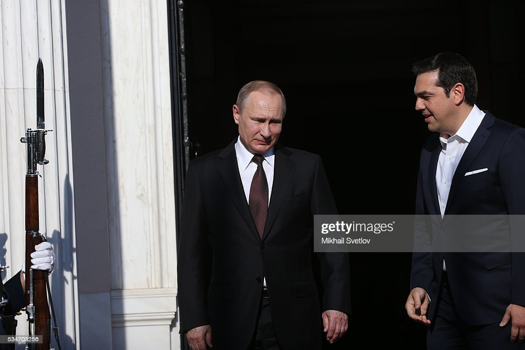 Russian President <a gi-track='captionPersonalityLinkClicked' href=/galleries/search?phrase=Vladimir+Putin&family=editorial&specificpeople=154896 ng-click='$event.stopPropagation()'>Vladimir Putin</a> (L) greets Prime Minister of Greece <a gi-track='captionPersonalityLinkClicked' href=/galleries/search?phrase=Alexis+Tsipras&family=editorial&specificpeople=6592450 ng-click='$event.stopPropagation()'>Alexis Tsipras</a> (R) during their meeting in Athens, Greece, May 27, 2016. <a gi-track='captionPersonalityLinkClicked' href=/galleries/search?phrase=Vladimir+Putin&family=editorial&specificpeople=154896 ng-click='$event.stopPropagation()'>Vladimir Putin</a> is having a state visit to Greece.