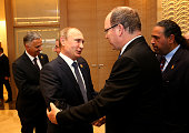 Russian President Vladimir Putin greets Prince Albert II of Monaco during the Opening Ceremony for the Baku 2015 European Games at the Olympic...