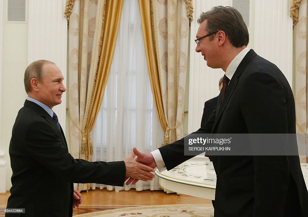 Russian President Vladimir Putin (L) greets Serbian Prime Minister Aleksandar Vucic during a meeting at the Kremlin in Moscow on May 26, 2016. / AFP / POOL / SERGEI