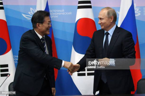 Russian President Vladimir Putin greets South Korean President Moon Jaein during their talks at the Eastern Economic Fourm on September 6 2017 in...