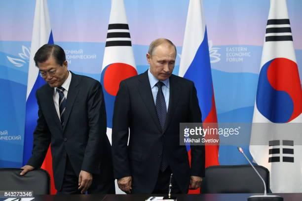 Russian President Vladimir Putin greets South Korean President Moon Jaein during their talks at the Eastern Economic Fourm on September 6 2017 in...