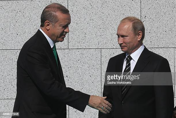 Russian President Vladimir Putin greets Turkish President Tayyip Erdogan during an opening ceremony for the newly restored Moscow Cathedral Mosque on...