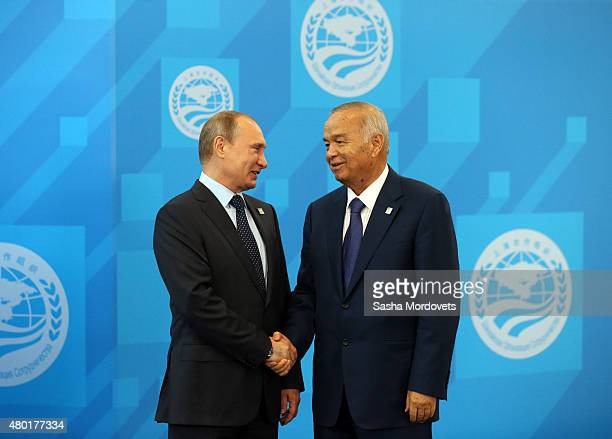 Russian President Vladimir Putin greets Uzbek President Islam Karimov during the Shanghai Cooperation Organisation Summit on July 10 2015 in Ufa...