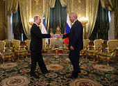 Russian President Vladimir Putin greets Uzbek President Islam Karimov during their meeting in the Grand Kremlin Palace on April 26 2016 in Moscow...