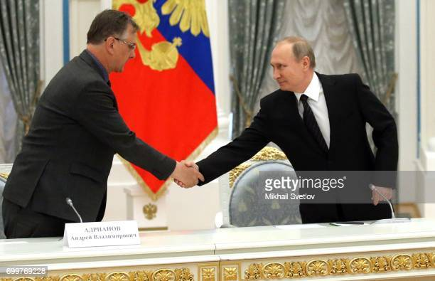 Russian President Vladimir Putin greets zoologist Andrey Adrianov during his meeting with members of Russian Academy of Sciences at the Kremlin on...