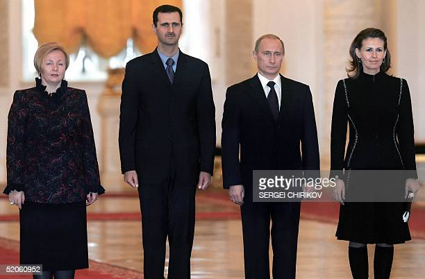 Russian President Vladimir Putin his wife Lyudmila Syrian President Bashar alAsad and his wife Asma pose for a picture during their meeting in...