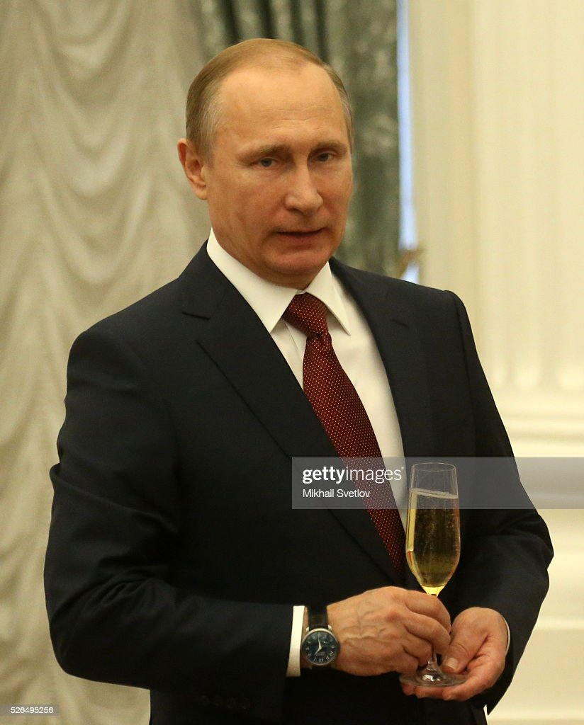 Russian President Vladimir Putin holds a glass during the awarding ceremony at the Kremlin April, 30, 2016 in Moscow, Russia. Putin presented Hero of Labour medals to five winners. The awards were given to Russians who made a considerable contribution to the country's social and economic development, including development of culture, education, industry and agriculture.