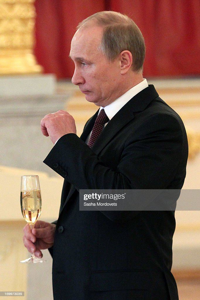 Russian President <a gi-track='captionPersonalityLinkClicked' href=/galleries/search?phrase=Vladimir+Putin&family=editorial&specificpeople=154896 ng-click='$event.stopPropagation()'>Vladimir Putin</a> holds a glass of champagne during a reception for new ambassadors in the Alexander Hall of the Grand Kremlin Palace January 24, 2013 in Moscow, Russia. Putin received 20 new foreign ambassadors.