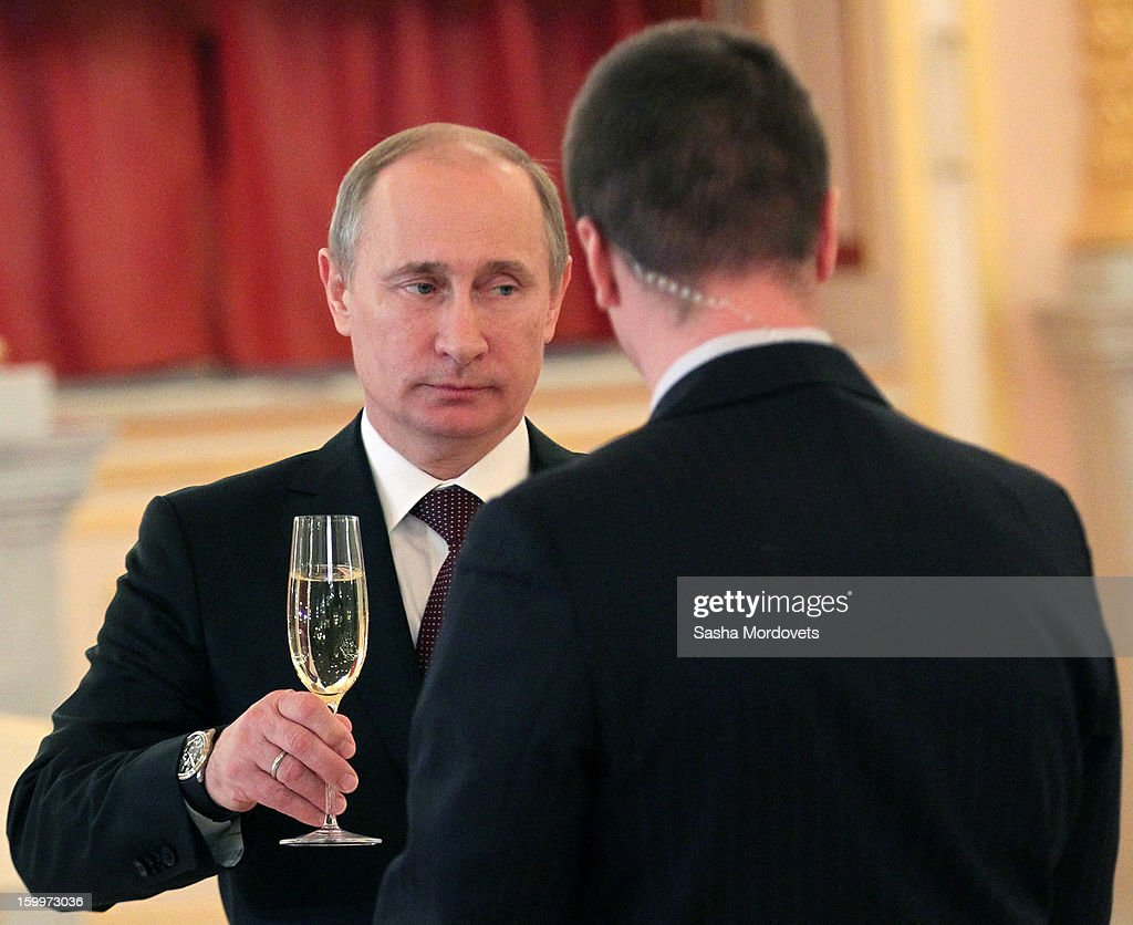 Russian President Vladimir Putin holds a glass of champagne during a reception for new ambassadors in the Alexander Hall of the Grand Kremlin Palace January 24, 2013 in Moscow, Russia. Putin received 20 new foreign ambassadors.