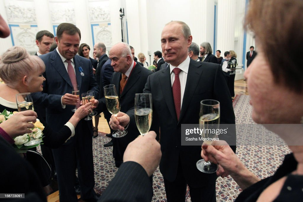 Russian President <a gi-track='captionPersonalityLinkClicked' href=/galleries/search?phrase=Vladimir+Putin&family=editorial&specificpeople=154896 ng-click='$event.stopPropagation()'>Vladimir Putin</a> holds a glass of champagne during an awards ceremony at the Kremlin on December 26, 2012 in Moscow, Russia. Putin awarded 40 actors, scientists, writers and other people in an annual ceremony for achievements in 2012.