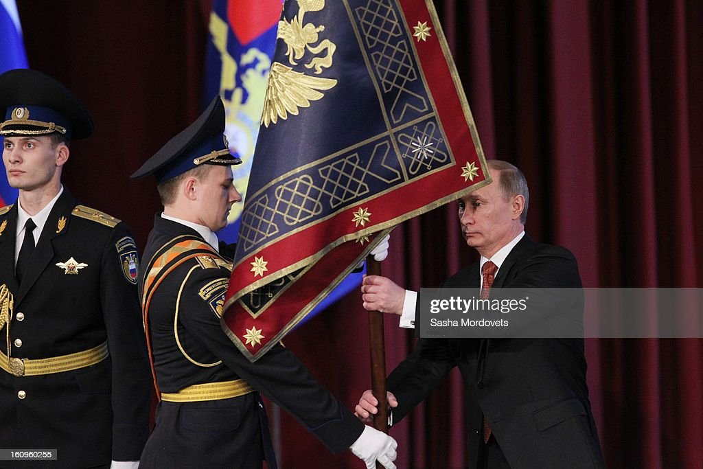 Russian President <a gi-track='captionPersonalityLinkClicked' href=/galleries/search?phrase=Vladimir+Putin&family=editorial&specificpeople=154896 ng-click='$event.stopPropagation()'>Vladimir Putin</a> holds a new flag of Russian Interior Minisrty at a meeting with top officers of Russian Interior Ministry on February 8, 2013 in Moscow, Russia. Putin 's meeting comes in the wake of him firing of top Russian Olympic official, Akhmed Bilalov, over incomplete venues for the 2014 Winter Games in Sochi.
