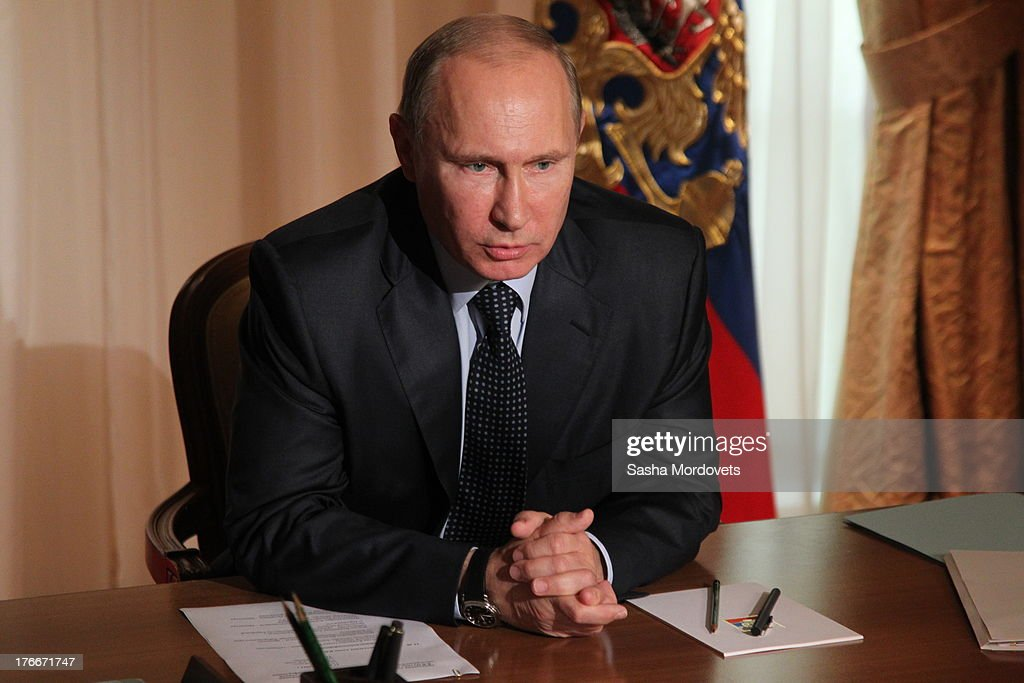 Russian President Vladimir Putin holds a satellite debate with governors of Russian Far Eastern on August 17, 2013 in Sochi, Russia. Eastern regions of Russia suffer from flood this week.
