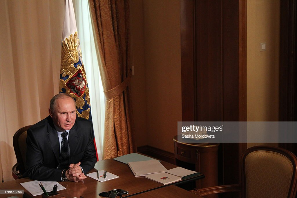 Russian President <a gi-track='captionPersonalityLinkClicked' href=/galleries/search?phrase=Vladimir+Putin&family=editorial&specificpeople=154896 ng-click='$event.stopPropagation()'>Vladimir Putin</a> holds a satellite debate with governors of Russian Far Eastern on August 17, 2013 in Sochi, Russia. Eastern regions of Russia suffer from flood this week.