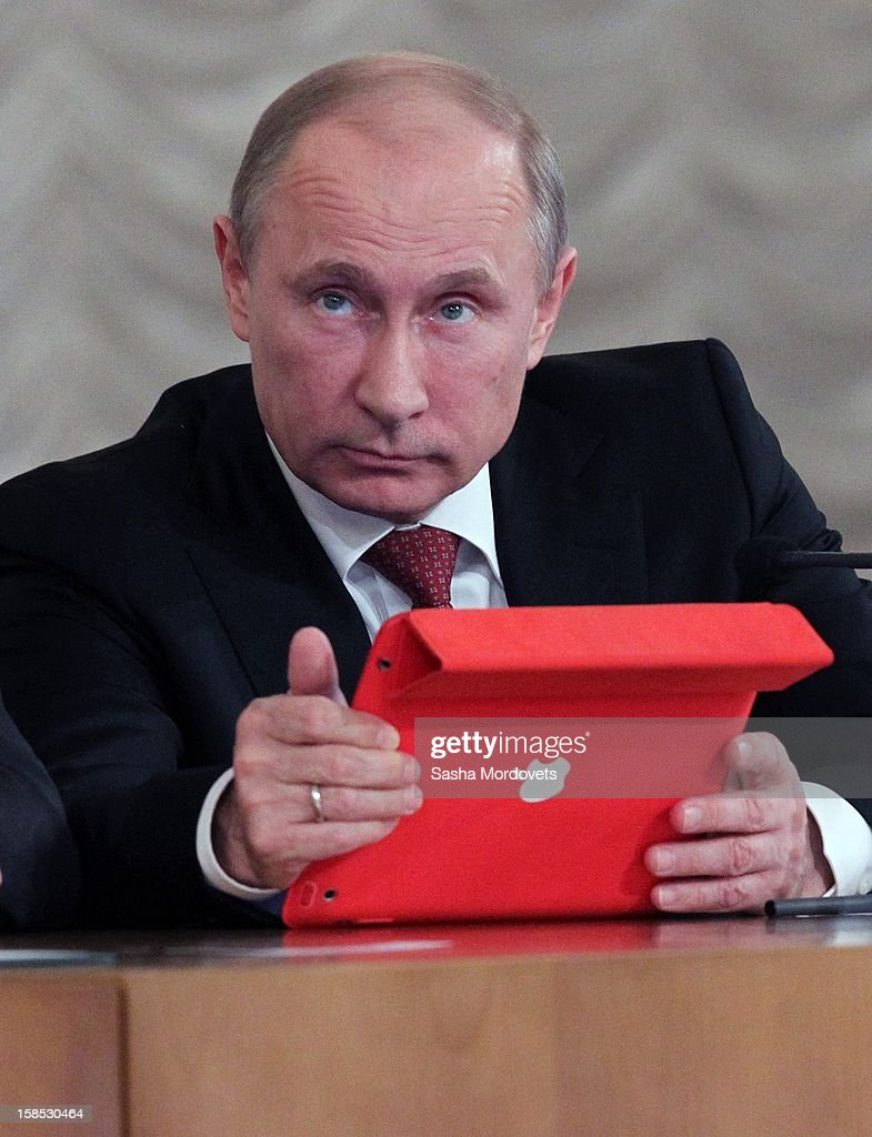Russian President <a gi-track='captionPersonalityLinkClicked' href=/galleries/search?phrase=Vladimir+Putin&family=editorial&specificpeople=154896 ng-click='$event.stopPropagation()'>Vladimir Putin</a> holds an Apple iPad during the all-Russia congress of judges on December 18, 2012in Moscow, Russia. In his speech Putin he reminded the participants that courts are very important state institutions and cautioned judges against mistakes, bureaucratic self-conceit and bribery.