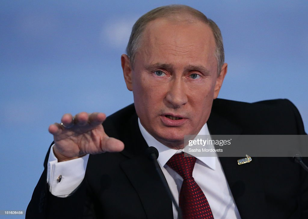 Russian President <a gi-track='captionPersonalityLinkClicked' href=/galleries/search?phrase=Vladimir+Putin&family=editorial&specificpeople=154896 ng-click='$event.stopPropagation()'>Vladimir Putin</a> holds his final press conference after a session of the Asian Pacific Economic Cooperation (APEC) Summit September 9, 2012 in Vladivostok, Russia. Leaders of APEC countries are gathered at Russky Island in Vladivostok to seek freer trade among member nations.
