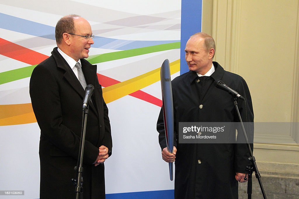 Russian President <a gi-track='captionPersonalityLinkClicked' href=/galleries/search?phrase=Vladimir+Putin&family=editorial&specificpeople=154896 ng-click='$event.stopPropagation()'>Vladimir Putin</a> (R) holds the 2014 Winter Olympics torch as <a gi-track='captionPersonalityLinkClicked' href=/galleries/search?phrase=Prince+Albert+II+of+Monaco&family=editorial&specificpeople=201707 ng-click='$event.stopPropagation()'>Prince Albert II of Monaco</a> looks on during a visit to an exhibition of Olympic torches from the collection of Albert II at the GUM department store at Red Square October 4, 2013 in Moscow, Russia. Prince Albert II will also be one of the dignitaries to carry the Olympic torch as it begins its four-month journey to Sochi next week.