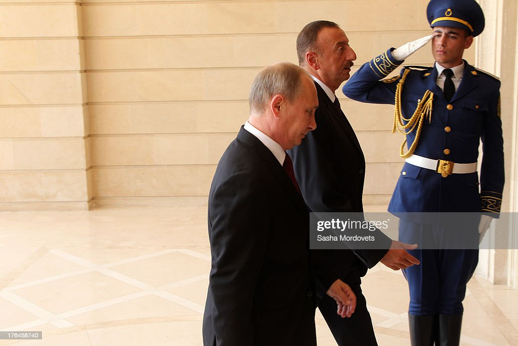 Russian President <a gi-track='captionPersonalityLinkClicked' href=/galleries/search?phrase=Vladimir+Putin&family=editorial&specificpeople=154896 ng-click='$event.stopPropagation()'>Vladimir Putin</a> (L) is greeted by Azerbaijani President <a gi-track='captionPersonalityLinkClicked' href=/galleries/search?phrase=Ilham+Aliyev&family=editorial&specificpeople=565601 ng-click='$event.stopPropagation()'>Ilham Aliyev</a> August 13, 2013 in Baku, Azerbaijan. Putin is in Azerbaijan for a one-day state visit.