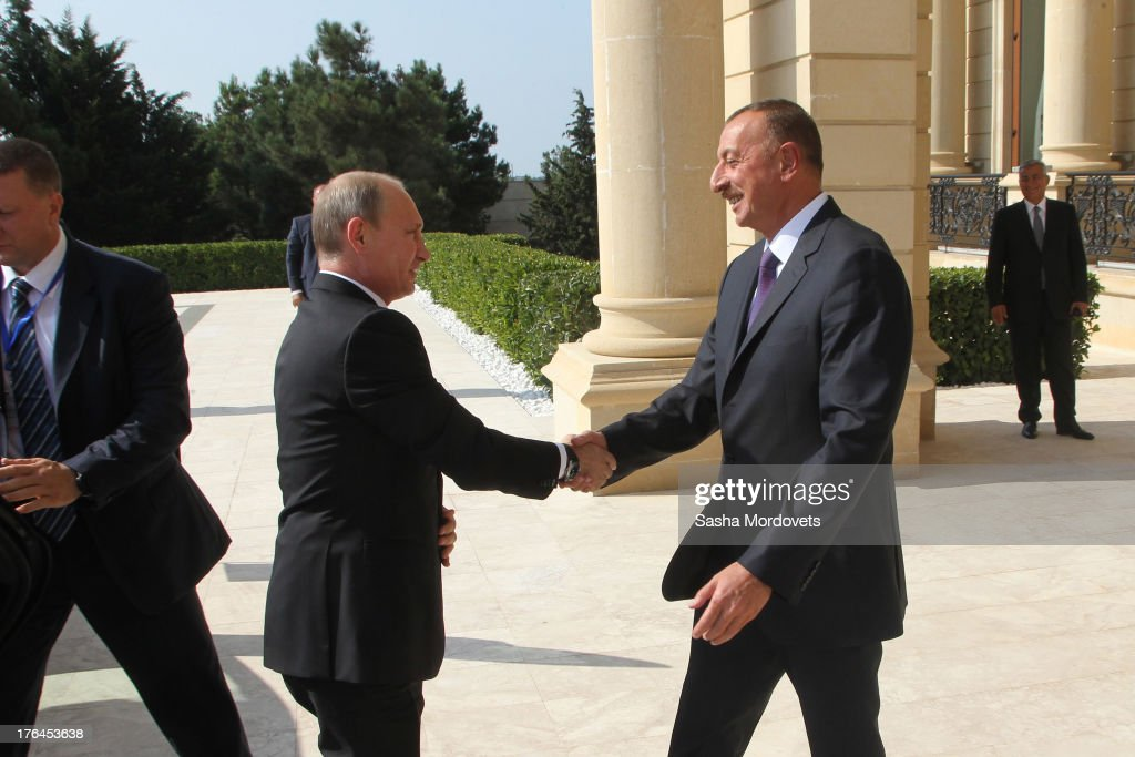 Russian President <a gi-track='captionPersonalityLinkClicked' href=/galleries/search?phrase=Vladimir+Putin&family=editorial&specificpeople=154896 ng-click='$event.stopPropagation()'>Vladimir Putin</a> (L) is greeted by Azerbaijan's President <a gi-track='captionPersonalityLinkClicked' href=/galleries/search?phrase=Ilham+Aliyev&family=editorial&specificpeople=565601 ng-click='$event.stopPropagation()'>Ilham Aliyev</a> (R) on August 13, 2013 in Baku, Azerbaijan. Putin will discuss a wide range of bilateral issues, including trade, energy and transportation during his one-day-visit.