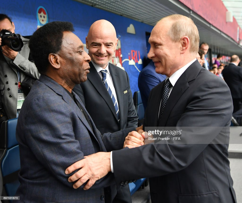 Russian President Vladimir Putin is greeted by Brazilian football legend Pele as FIFA president Gianni Infantino looks on prior to the FIFA Confederations Cup Group A match between Russia and New Zealand at Saint Petersburg Stadium on June 17, 2017 in Saint Petersburg, Russia.