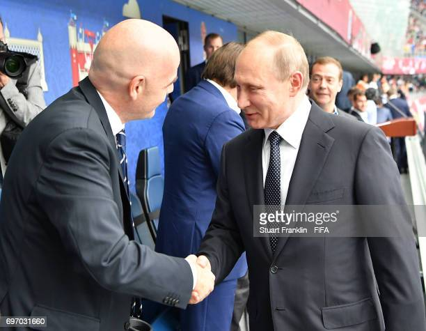 Russian President Vladimir Putin is greeted by FIFA president Gianni Infantino prior to the FIFA Confederations Cup Group A match between Russia and...