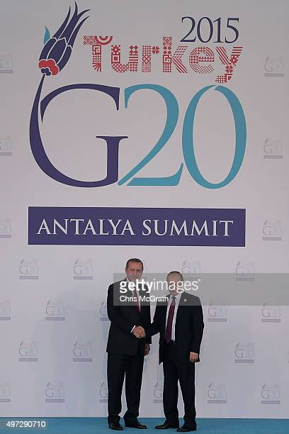 Russian President Vladimir Putin is greeted by Turkish President Recep Tayyip Erdogan during the official welcome ceremony on day one of the G20...