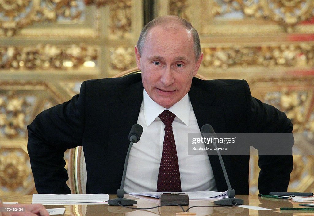 Russian President <a gi-track='captionPersonalityLinkClicked' href=/galleries/search?phrase=Vladimir+Putin&family=editorial&specificpeople=154896 ng-click='$event.stopPropagation()'>Vladimir Putin</a> is seen during a meeting with ministers to submit a message on the 2012-2014 budget policy in the Grand Kremlin Palace on June 13, 2013 in Moscow, Russia. British Prime Minister David Cameron will host Russian President <a gi-track='captionPersonalityLinkClicked' href=/galleries/search?phrase=Vladimir+Putin&family=editorial&specificpeople=154896 ng-click='$event.stopPropagation()'>Vladimir Putin</a> at Downing Street on Sunday to discuss the conflict in Syria before the leaders meet at the G8 conference in Northern Ireland next week.