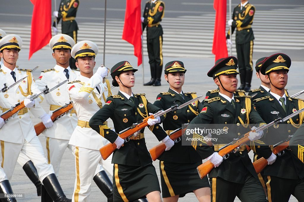 Russian President Vladimir Putin (not seen) is welcomed by Chinese guard of honor with an official welcoming ceremony in Beijing, China on June 25, 2016.