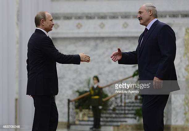 Russian President Vladimir Putin is welcomed by President of Belarus Alexander Lukashenko ahead of the summit held for the situation in Ukraine with...