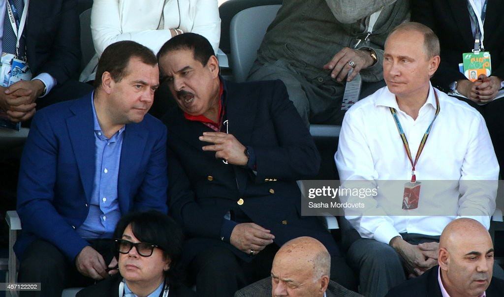 Russian President <a gi-track='captionPersonalityLinkClicked' href=/galleries/search?phrase=Vladimir+Putin&family=editorial&specificpeople=154896 ng-click='$event.stopPropagation()'>Vladimir Putin</a> (R), King of Bahrain Hamad bin Isa Al Khalifa (C) and Prime Minister <a gi-track='captionPersonalityLinkClicked' href=/galleries/search?phrase=Dmitry+Medvedev&family=editorial&specificpeople=554704 ng-click='$event.stopPropagation()'>Dmitry Medvedev</a> (L) watch 2014 Formula One Russian Prize races October 12, 2014 in Sochi, Russia.