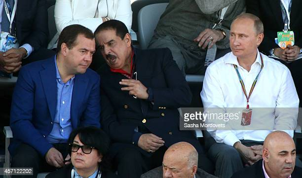 Russian President Vladimir Putin King of Bahrain Hamad bin Isa Al Khalifa and Prime Minister Dmitry Medvedev watch 2014 Formula One Russian Prize...