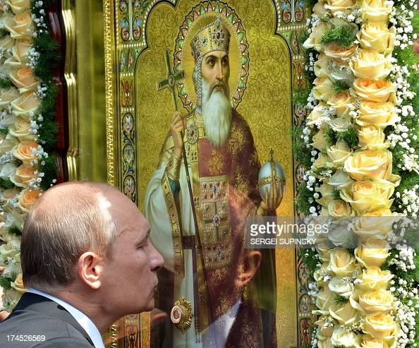 Russian President Vladimir Putin kisses an icon during a service and ceremony in Kiev on July 27 2013 to celebrate the 1025th anniversary of...