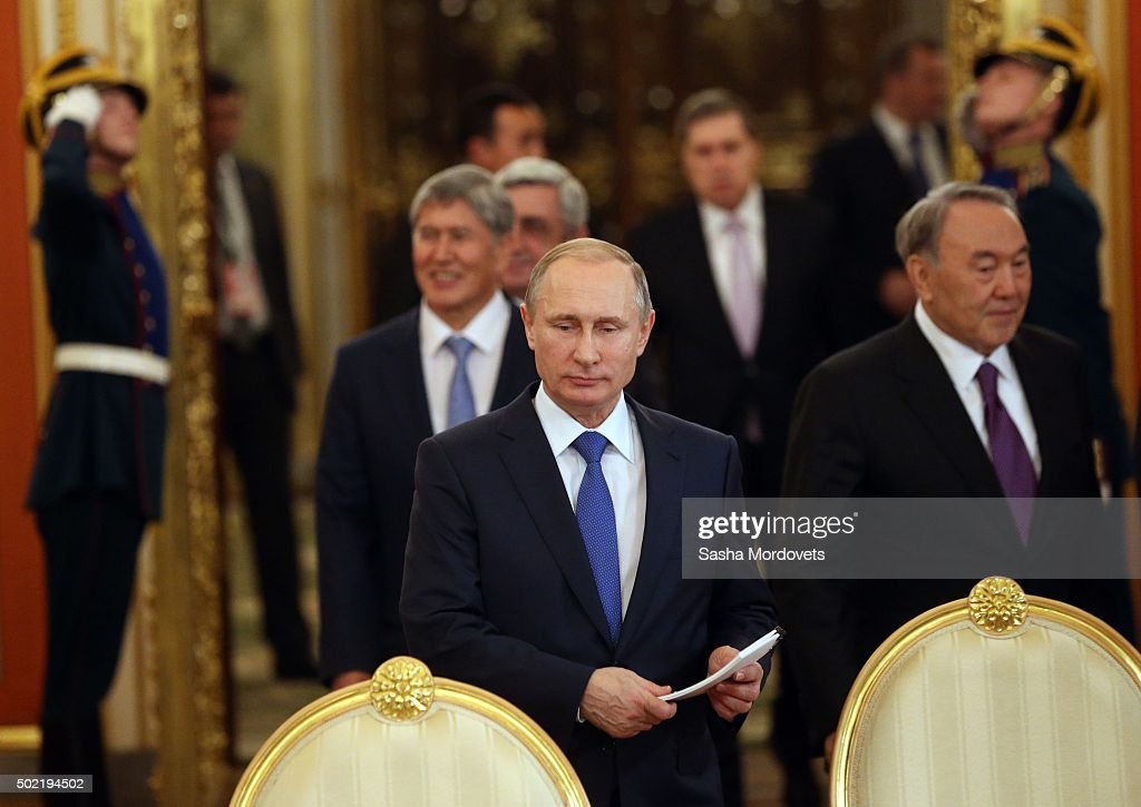 Russian President Vladimir Putin (C), Kyrgyz President Almazbek Atambayev (L) and Kazakh President Nursultan Nazarbayev (R) seen during the Summit of Eurasian Economic Union in Grand Kremlin Palace December 21, 2015 in Moscow, Russia. Leaders of post-Soviet states have gathered in Moscow for the CSTO Summit and Eurasian Economic Union Summit.